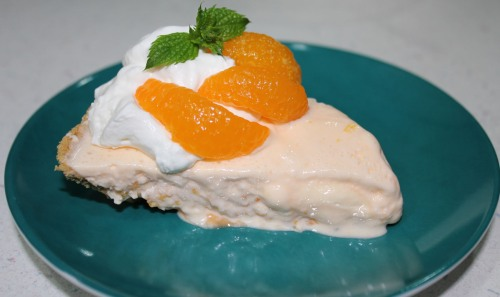 I skipped a few steps here as the ice cream was melting way too fast in our hot house.  Pour mix into pie pan. Freeze for three hours (or longer)  and garnish with whipped cream, Mandarin oranges and a sprig of mint if you want  to get all fancy-pants. Which I did. And it was yummy.