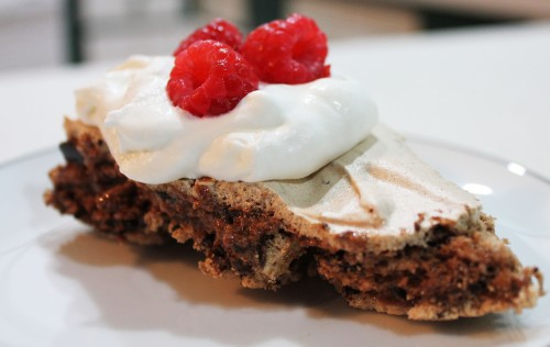Cool completely in the oven, slice and serve with freshly whipped cream and berries.