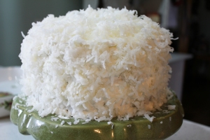 Smother the cake in shredded, sweetened coconut.