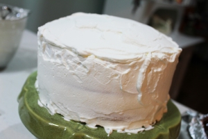 Cover the entire cake with whipping cream. At this point, I freeze the cake until I'm ready to serve. Even if you are making it the same day you want to serve, at least give it time to get thoroughly chilled in the fridge. Serving it cold is part of what makes it so good.