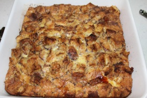 Cut baked bread pudding into slices and serve with warm syrup. It will make your knees wobbly and your stomach very happy.