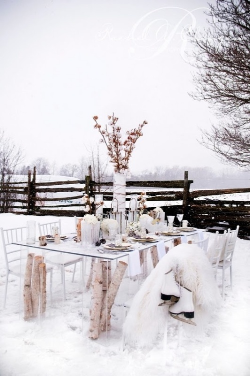 This table from Rachel A. Clingen Wedding Design is lovely, although there aren't enough layers of thermal to get me to sit outside and dine.
