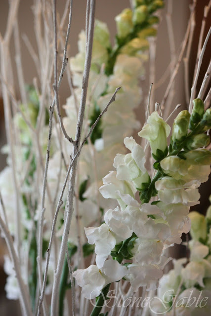 Love the white snapdragons with the white twigs from Stone Garden.