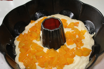 Pour half of the batter into greased bundt pan. Sprinkle in peaches. Top with remaining batter.