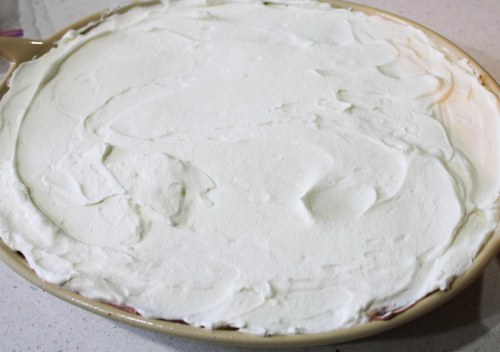 Spread whipping cream evenly over the top. You can get all fancy and make designs... or not.