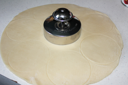 Unfold pie dough then using a circle cutter/sealer to mark circles on the dough. Do not cut into the dough, just outline circles.