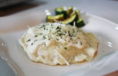Top with creamy alfredo sauce, a sprinkling of Parmesan cheese and parsley. Serve with a side of roasted zucchini or a fresh garden salad.