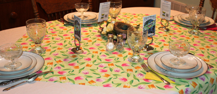 Here's the table, set with a cheerful tulip cloth and bright pink and yellow napkins.