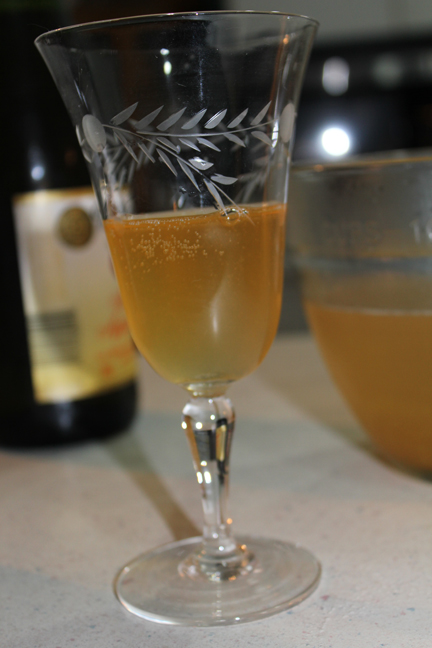 Pour syrup into a champagne flute (isn't this vintage one pretty?) then add sparking peach juice.