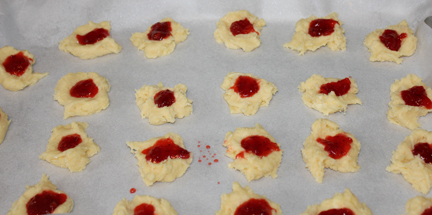 Create an indent in each drop with your thumb and fill with jam.