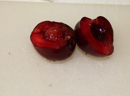 Start by pitting your cherries.