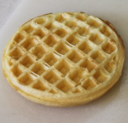 Toast a frozen waffle until it is crunchy.