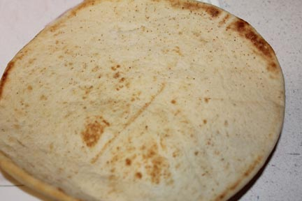 Toast your Pita bread - just until it's warm.