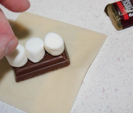 Add mini-marshmallows. If you use more than three it's almost impossible to get the wrap to seal.