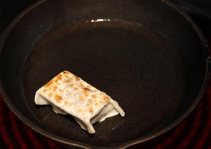Heat oil in a heavy skillet on medium heat and fry for just a few seconds on each side until wrap is brown. Do not overcook! If you do, your marshmallows will disappear.