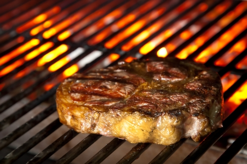 Juicy steak on barbecue