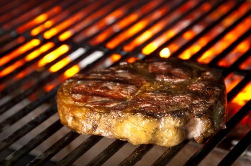 Juicy steak on barbecue